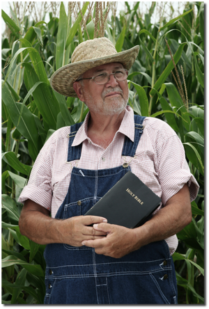 farmer holding Bible