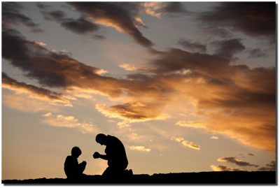 man and child kneeling in prayer
